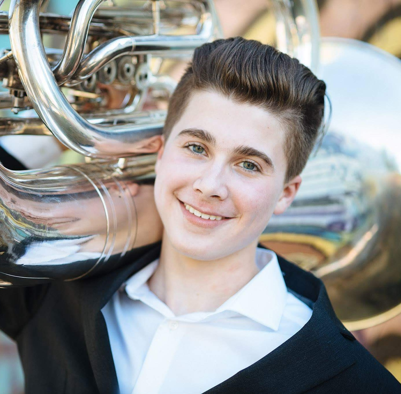 Jack Crepeau poses with his tuba Photo By Dennis Webber