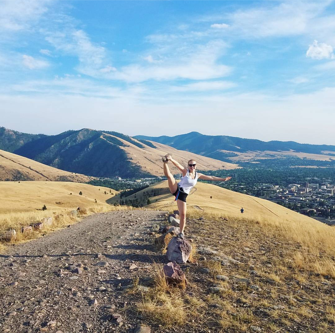 Thea Jonassen poses for the camera on one of her favorite trails in Missoula.