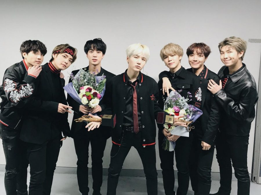 BTS Posing for their fans afgter recieving an award Photo By @bts_twt