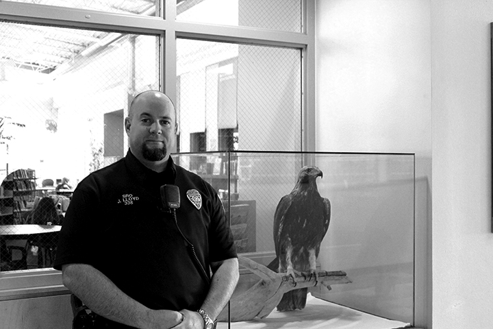 officer Loyd standing in front of the library