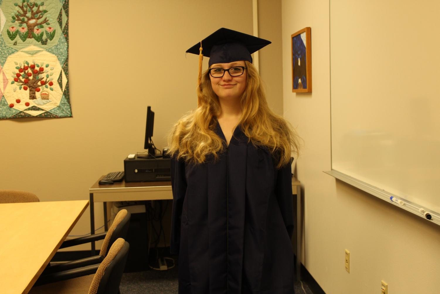 Early graduate Kyla Kingrey wearing her cap and gown