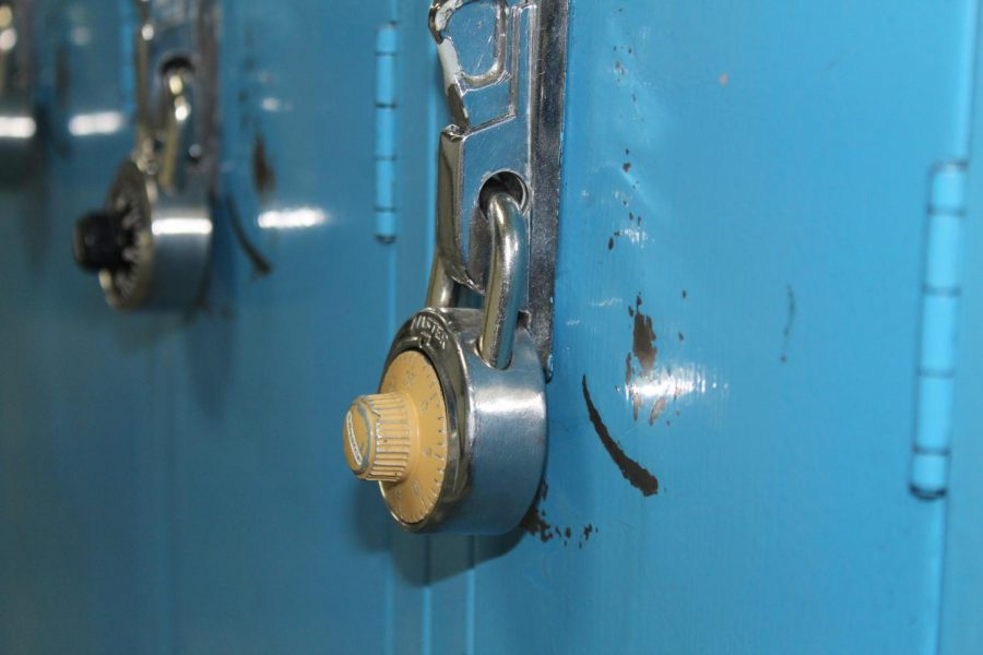 yellow combination lock on blue locker.