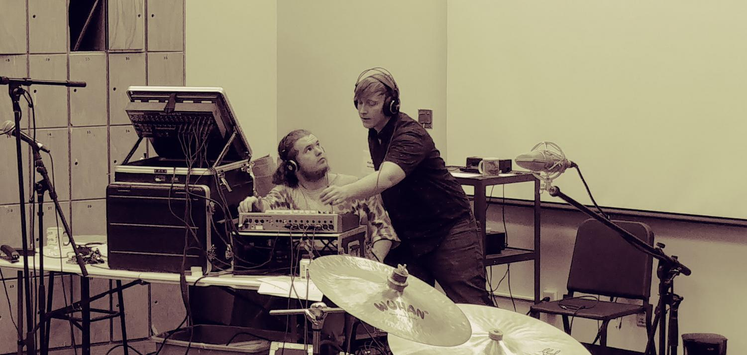 Wilson and a friend work on the sound mix for a project. Says Wilson of his experience in the drama tech program,