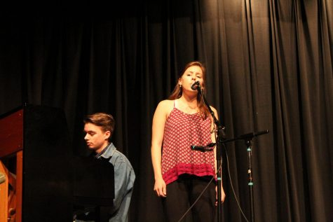 Abigail Rocicot performing 'Apart Of Your World' from The Little Mermaid. Accompanied by her older brother.