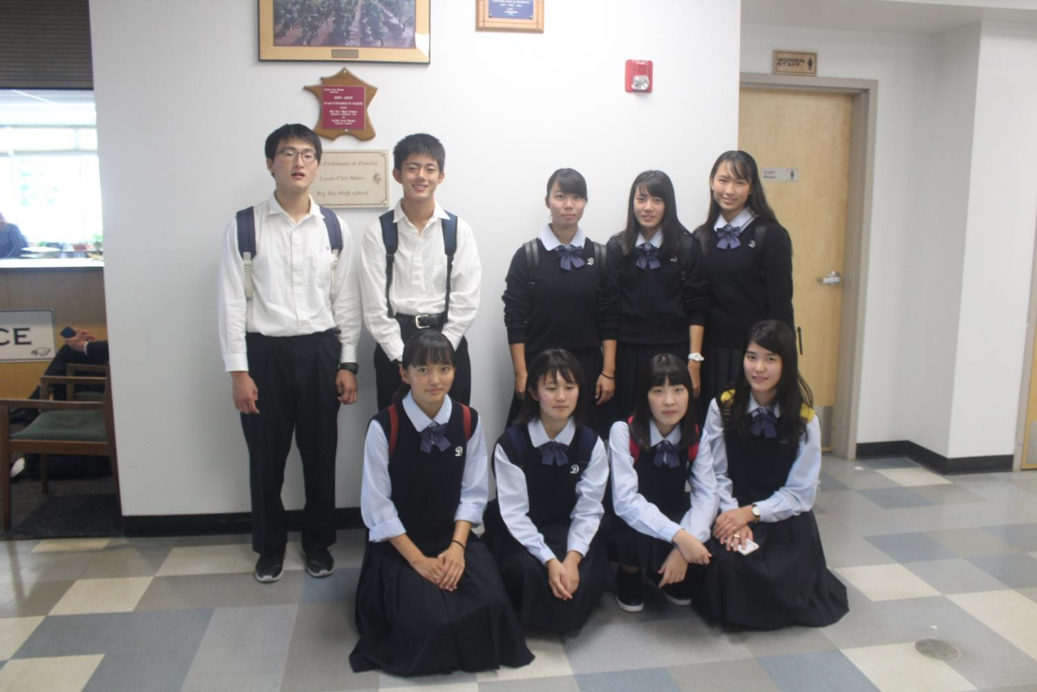 Students from Daini High School in Kumamoto, Japan, pose for a photo near the main office.