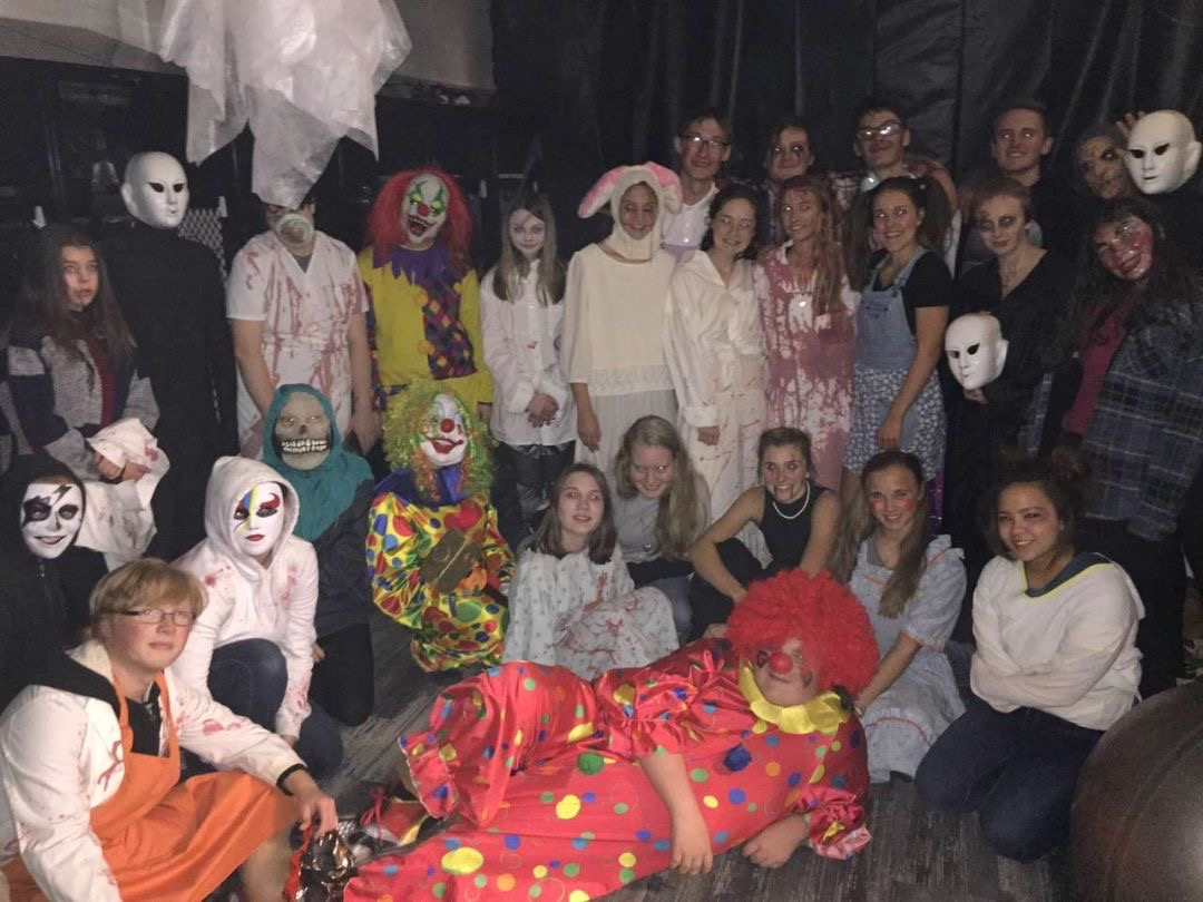 Cast of haunted house poses for a picture after successful opening night.