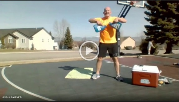 a man works out in a driveway with laundry bottles
